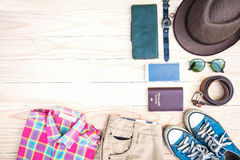 Casual apparel and accessories on a wood background Stock Images
