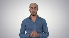 Casual arab man talking to camera explaining something on gradient background. Close up. Casual arab man talking to camera explaining something on gradient stock video footage