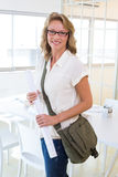 Casual architect smiling at camera holding blueprint Royalty Free Stock Photos