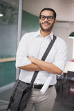 Casual architect smiling at camera holding blueprint Stock Photography