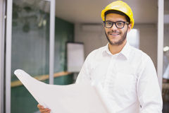 Casual architect studying his blueprints Stock Photo