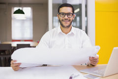 Casual architect studying his blueprints Royalty Free Stock Photography