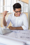 Casual architect working with laptop at desk Royalty Free Stock Photography