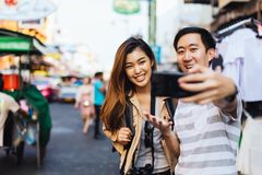 Casual Asian couple taking selfie while traveling stock images
