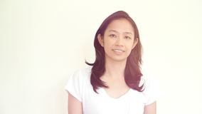 Casual asian girl on white background smiling face with relax te Royalty Free Stock Image