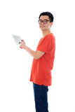 Casual asian male with tablet stock image