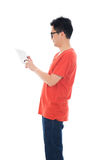 Casual asian male with tablet Royalty Free Stock Photo