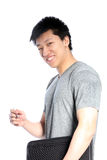 Casual Asian Man with a Binder and Pen Stock Image
