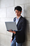Casual Asian Man with laptop Stock Photography
