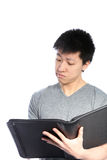 Casual Asian Man Looking Inside Binder Stock Photography