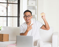 Casual asian man online shopping Stock Photography