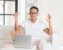 Casual asian man online shopping Stock Images