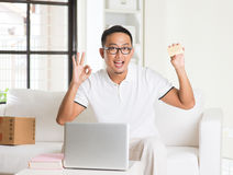 Casual asian man online shopping Royalty Free Stock Image