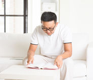 Casual asian man reading stock images