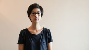 Asian woman  with short hair and glasses on color background Royalty Free Stock Photos
