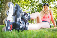 Casual attractive blonde wearing roller blades and helmet Stock Photos