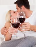 Couple toasting with red wine Royalty Free Stock Images