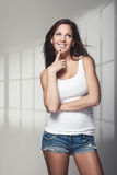 Casual attractive young girl in denim jeans Royalty Free Stock Images