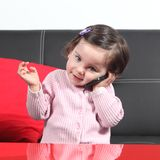 Casual baby on the phone. Portrait of a casual baby on the phone at home Stock Images