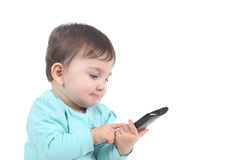 Casual baby touching a mobile phone Royalty Free Stock Photo
