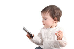 Casual baby watching a mobile phone Royalty Free Stock Images