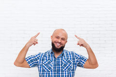Casual Bald Bearded Business Man Smiling Point Fingers Up Head Stock Photos