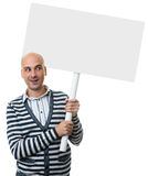 Casual bald man holding placard on a stick Royalty Free Stock Photos