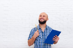 Casual Bearded Business Man Holding Folder Pencil Point Look Up To Copy Space Stock Photo