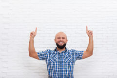 Casual Bearded Business Man Smiling Point Fingers Up To Copy Space Royalty Free Stock Photo