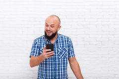 Casual Bearded Business Man Surprised Holding Cell Smart Phone Stock Images