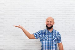Casual Bearded Man Smiling Open Palm Hand Gesture To Copy Space Royalty Free Stock Images