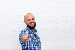 Casual Bearded Man Smiling Point Fingers At You. Over White Brick Wall Stock Images