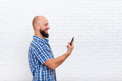 Casual Bearded Man Using Cell Smart Phone Happy Smile Royalty Free Stock Image