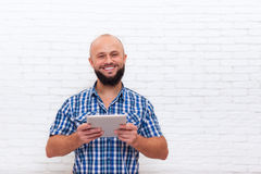 Casual Bearded Man Using Tablet Computer Happy Smile Stock Images