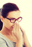 Casual beautiful woman in eyeglasses with tissue. Royalty Free Stock Photo