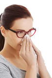 Casual beautiful woman in eyeglasses with tissue. Stock Image