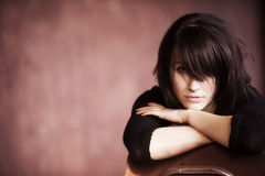 Casual beauty. Young beautiful girl staring at camera with messy casual hairstyle Royalty Free Stock Photo