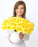Casual Beauty. Portrait of beautiful young woman holding vase of flowers royalty free stock photo