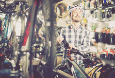 Casual biker cyclist is buying high-speed bike Royalty Free Stock Images