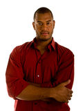 Casual Black Man in Red Shirt Arms Crossed Stock Image