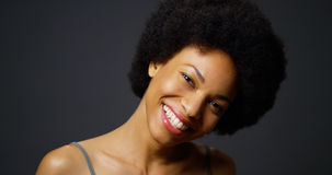 Casual black woman laughing and smiling Royalty Free Stock Photo