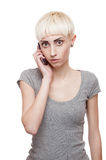 Casual blond girl holding cell phone Royalty Free Stock Images