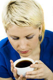 Casual blond woman having a coffee royalty free stock photo