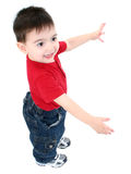 Casual Boy Happy Over White. Adorable toddler boy with arms out 'this big' and smile over white. Shot with the Canon 20D royalty free stock photos