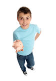 Casual boy holds a money box in palm of hand Royalty Free Stock Photos