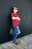 Casual boy leaning against wall Royalty Free Stock Photo
