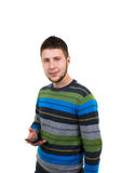 Casual boy with mobile phone Royalty Free Stock Image