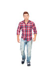 Casual boy with plaid shirt walking Stock Image