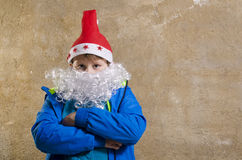 Casual boy with Santa costume Royalty Free Stock Image