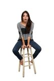 Casual Brunette on a Barstool (2) Royalty Free Stock Photos
